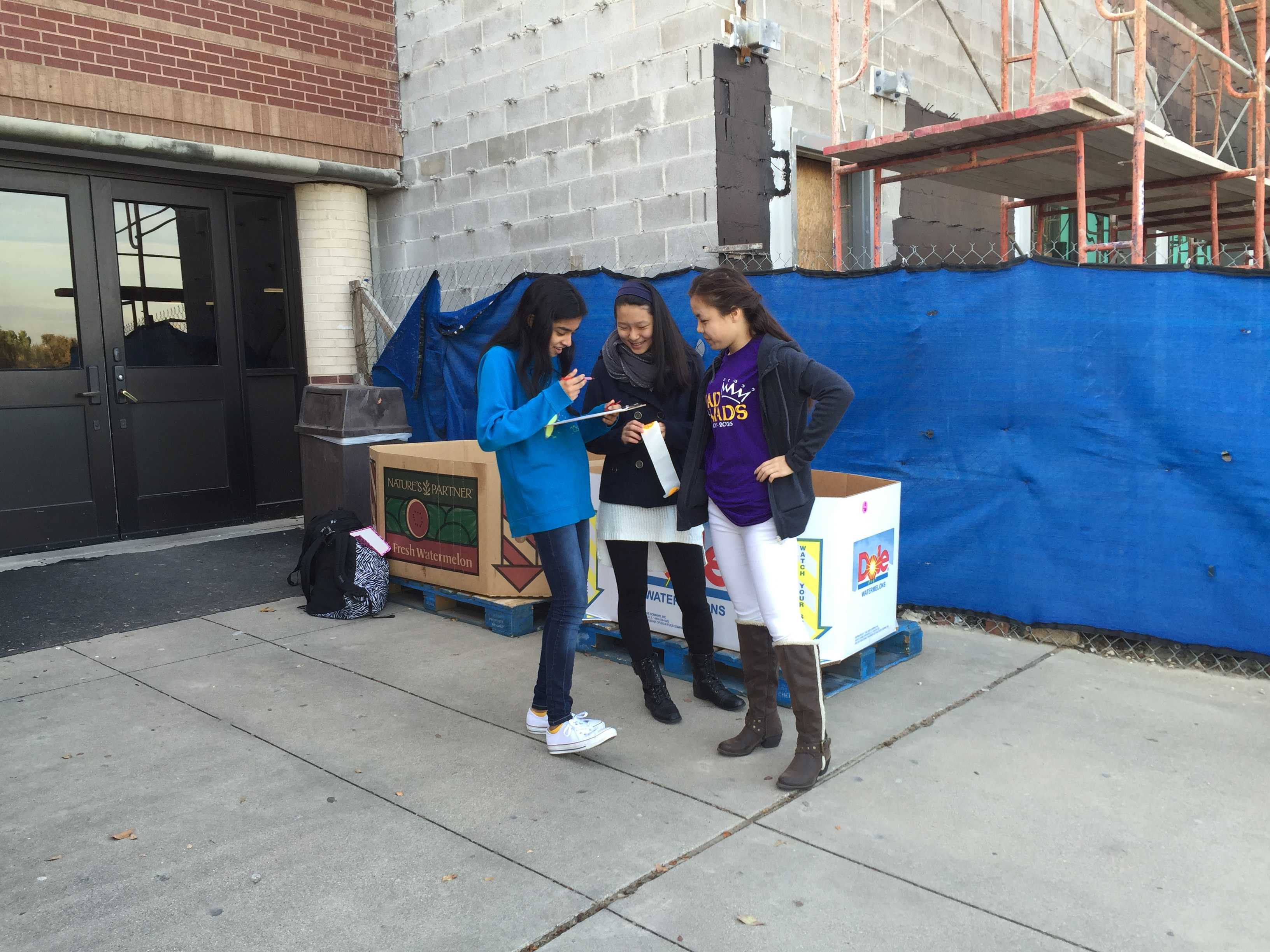 CHS sophomores and Student Council members, Riya Mahesh, Sol Hong, and Jasmine Lau, help out with the annual turkey drive on Nov. 20. Students and parents were able to donate turkeys and chickens to the North Texas Food Bank.