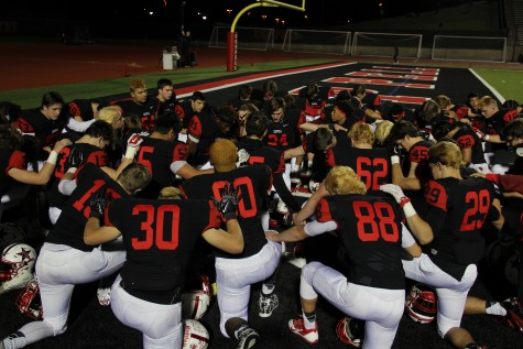 Coppell High School varsity football players come together before the game against Haltom to pray. After the last home game at Buddy Echols Field for this season The Cowboys beat The Buffalos 44-5 on Friday night. Photo by Megan Winkle