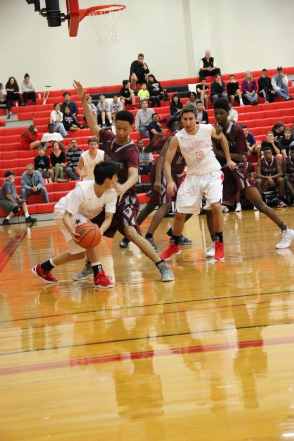 Coppell+High+School+senior+guard+Peyton+Chun+plays+offense+against+Mansfield+Timberview.+The+Cowboys+beat+the+Wolves+Friday+at+home+in+the+large+gym+54-52.