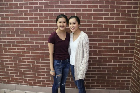 """Coppell High School sophomores Robin Li and Megan Li are identical twins. The girls' personalities are both very different. Megan is more talkative and girly while Robin is more reserved and direct. A physical distinguishing feature between them is that Megan has a mole on the top of her head while Robin does not."