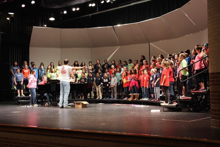 CISD fifth grade students unite for rehearsal for their show on Thursday. This is an annual event held by the high school in tandem with high school, middle school and elementary school level choir and music teachers.
