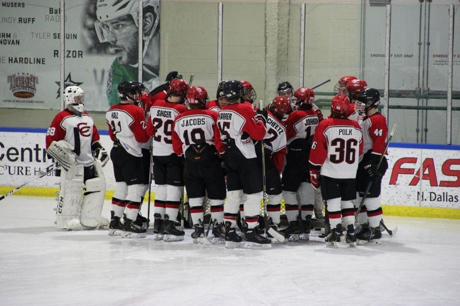 The Coppell Cowboys Varsity Hockey team celebrates after the second goal is scored Thursday night against Plano West at the Dr. Pepper Starcenter in Plano. The Cowboys won 4-2.