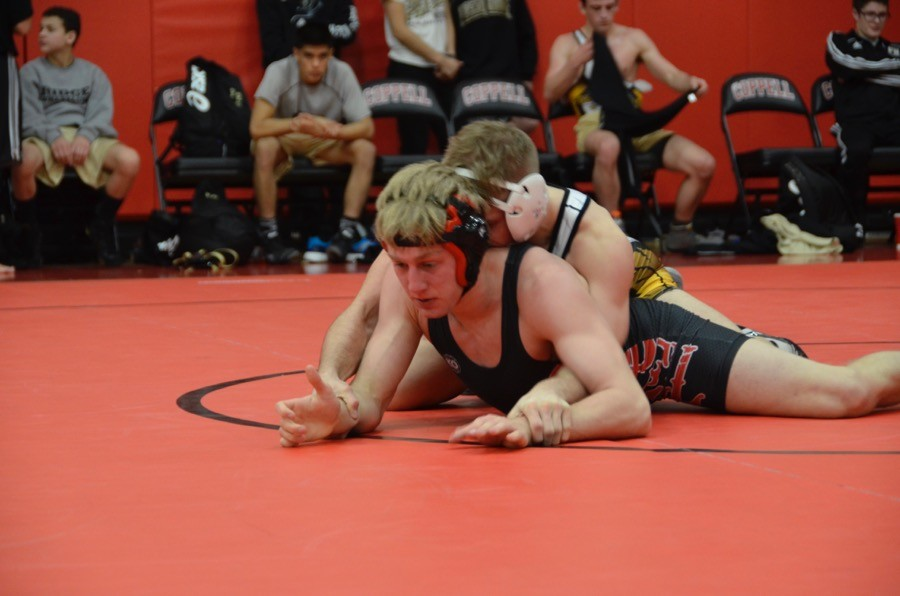 Coppell+High+School+senior+Ryan+Kinder+gets+pin+down+by+his+Panthers+opponent+on+Thursday+at+the+Coppell+High+School+small+gym.+The+JV+wrestling+team+prepares+to+go+against+Flower+Mound+in+the+District+6+JV+Championships+this+Wednesday.