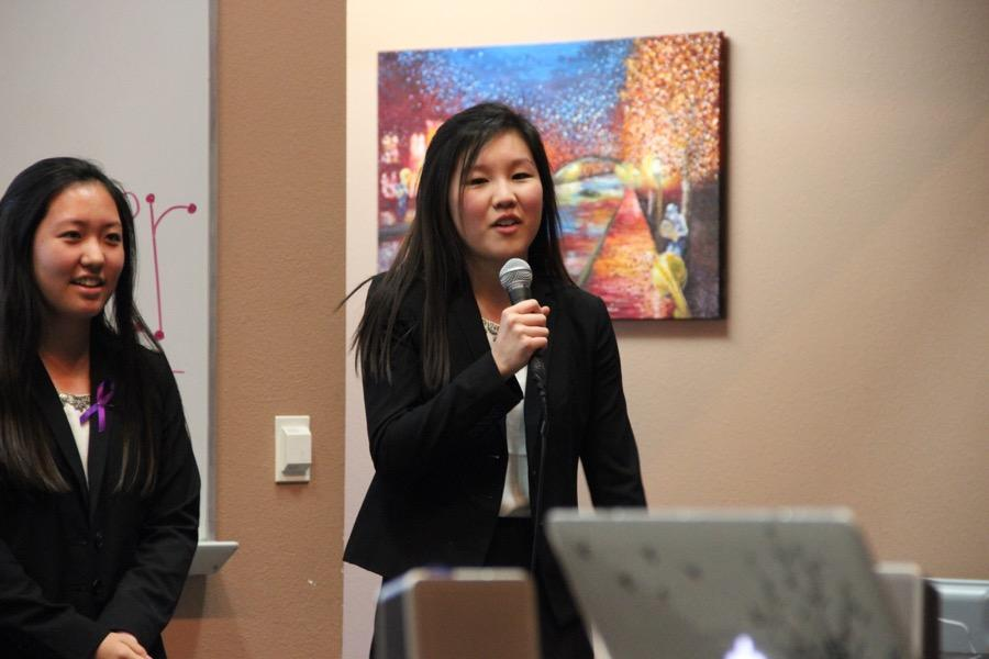 Coppell High School sophomore Sarah Koh introduces herself and talks about how her attendance to a memorial center enlightened her knowledge about Alzheimer's disease on Monday in the lecture hall. Koh is in HOSA and is presenting a public service announcement to bring more awareness for the Alzheimer's disease.