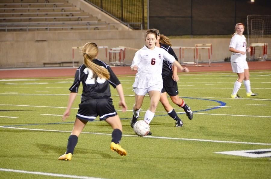 Coppell+High+School+sophomore+Ashley+Rivera+kicks+the+soccer+ball+across+the+field+last+Friday+at+Buddy+Echols+Field.+The+Coppell+Cowgirls+won+1-0+against+Colleyville+Heritage.+