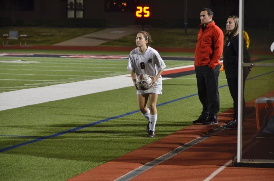 Coppell High School sophomore Ashley Rivera looks to throw the ball back onto the field last Friday at Buddy Echols Field. The Coppell Cowgirls won 1-0 against Colleyville Heritage.
