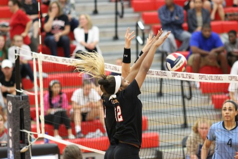 Coppell high school volleyball players Amarachi Osuji and Kylie Hagen-breitenwischer block a hit by L.D. Bell on  Oct. 20th. The Cowgirls finished 2nd in District 7-6A. Photo by Amanda Hair.