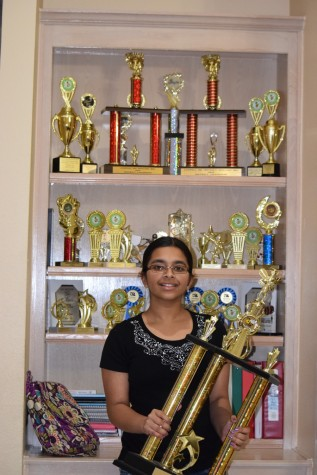 """Smrithi Upadhyayula, a eighth grader at CMSW (Coppell Middle School West), has been competing in spelling bee's since second grade and reached the National Scripps Bee last year for the first time. Her mother, Padmini Upadhyayula, said her favorite moment was, """"...when she threw her hands up in the air and screamed 'Yes ', after spelling the Championship Word in last year's Dallas Morning New Regional Spelling Bee."""""""