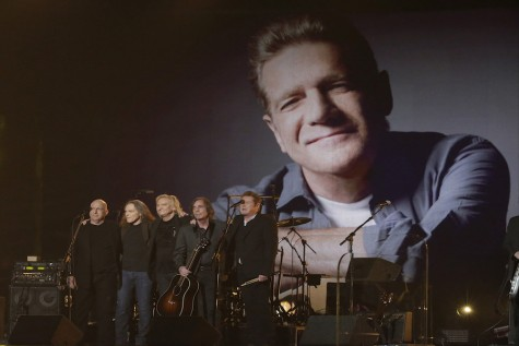 An image of the late Glenn Frey is displayed on a video screen as recording artists Bernie Leadon, from left, Timothy B. Schmit, Jackson Browne, Joe Walsh, Steuart Smith and Don Henley onstage take a bow following their performance at the 58th Annual Grammy Awards on Monday, Feb. 15, 2016, at the Staples Center in Los Angeles. (Robert Gauthier/Los Angeles Times/TNS)