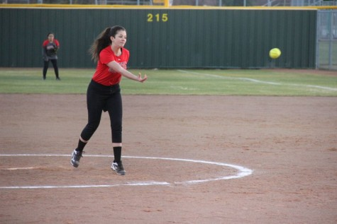 Coppell High School freshman Emily Heffernan pitches the ball the opponent team player. Coppell JV II scrimmaged against Allen at the Coppell ISD baseball/softball complex on Monday.