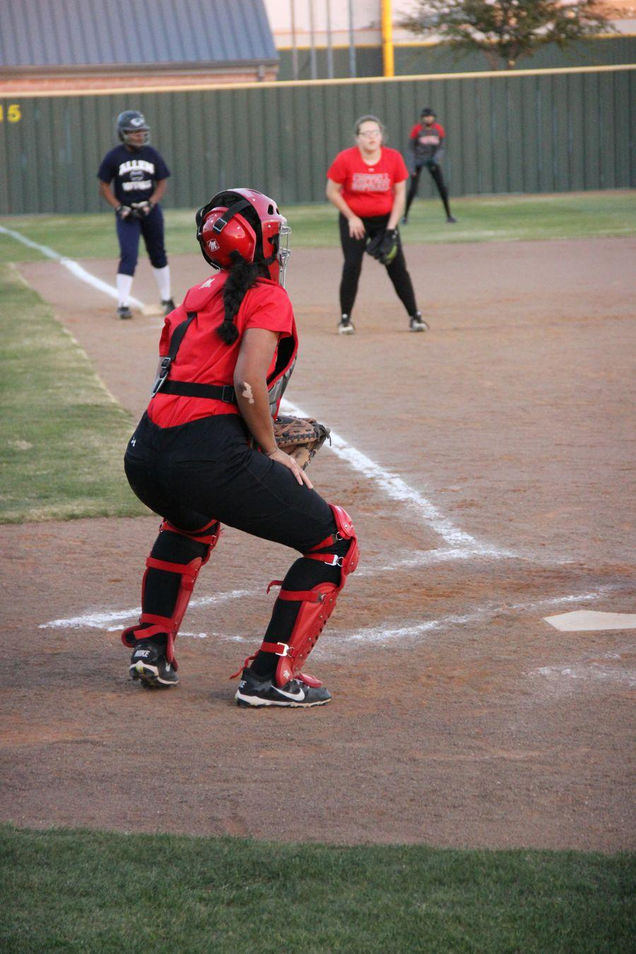 Coppell+High+School+sophomore+Iris+Loya+warms+up+catching+for+the+scrimmage+against+Allen.+Coppell+JV+II+scrimmaged+Monday+night+at+the+Coppell+ISD+baseball%2Fsoftball+complex.%0A