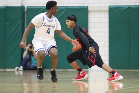 Freshman guard Tariq Aman looks for an open lane in the Duncanville defense during Coppell's 72-61 overtime loss to the Panthers. Throughout the season, Aman was one of the biggest contributors from underclassman and will be looked upon next year as a key piece of the program.