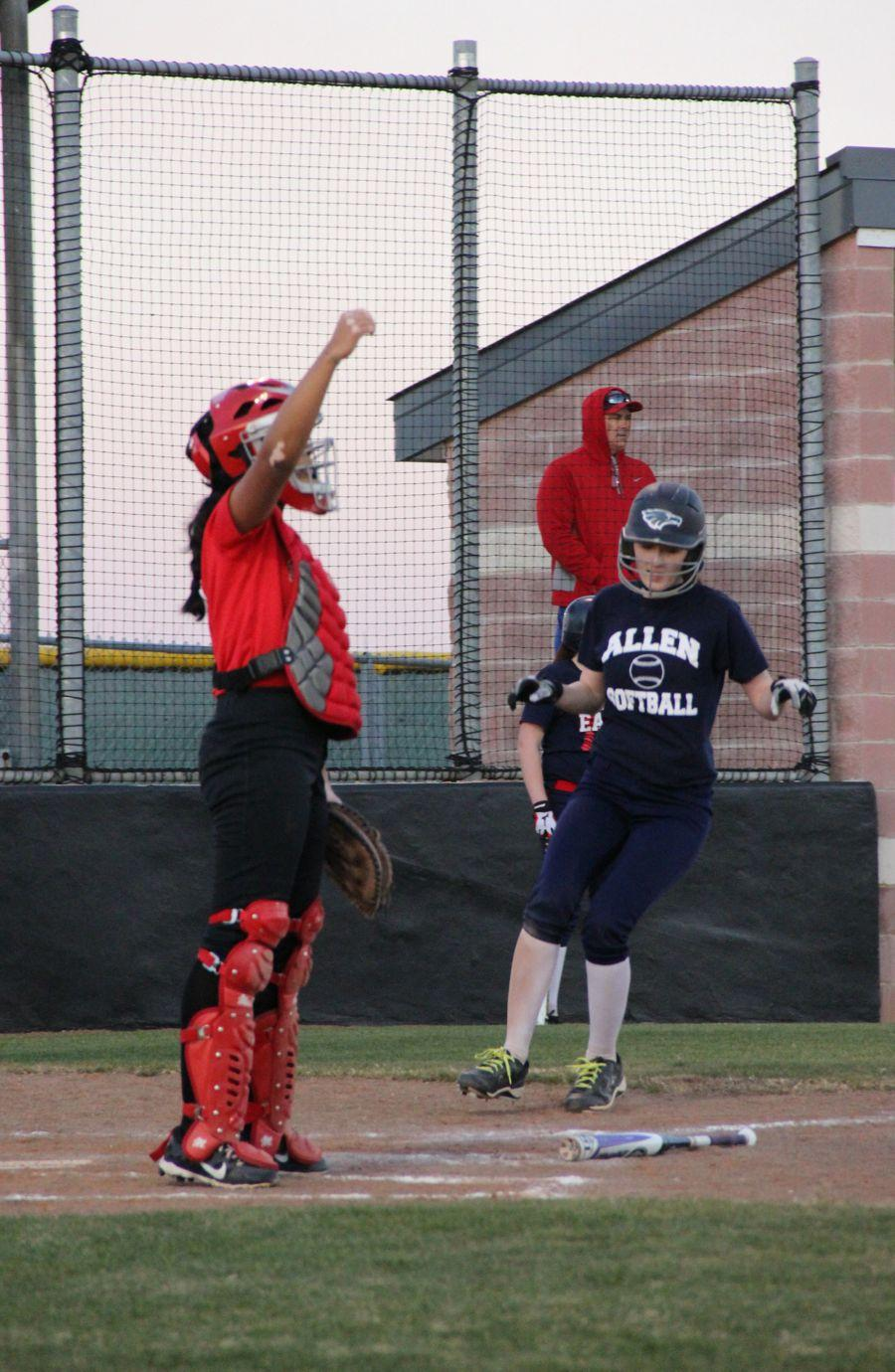 Allen+player+scores+run+while+Coppell+High+School+sophomore+Iris+Loya+waits+for+the+ball+to+come+to+home+plate+on+Monday.+Coppell+JV+II+scrimmaged+against+Allen+at+the+Coppell+ISD+baseball%2Fsoftball+complex.%0A