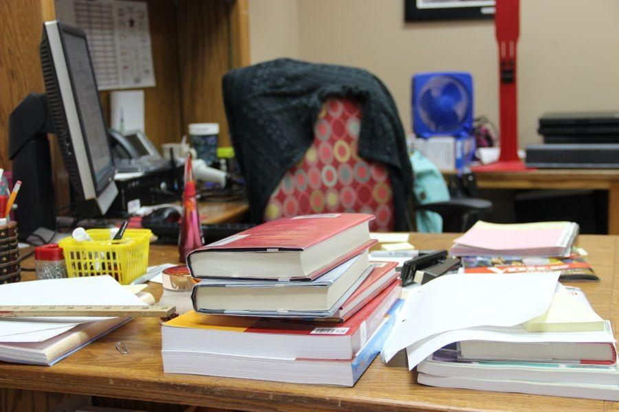 The+librarians+have+much+to+deal+with+as+clutter+piles+up+on+their+desks.