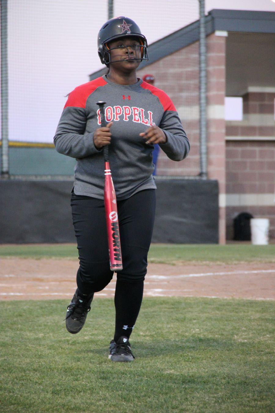 Coppell+High+School+junior+Adaqu+Ngwu+runs+runs+to+the+dugout+at+the+Coppell+ISD+baseball%2Fsoftball+complex.+Coppell+JV+II+scrimmaged+against+Allen+on+Monday.%0A