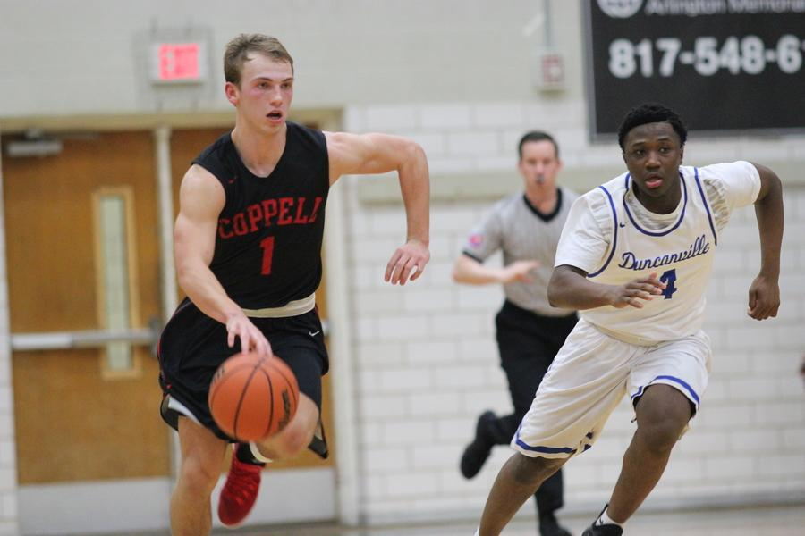 Senior guard Josh Fink brings the ball up the court in the Cowboys' 72-61 loss to Duncanviille. Fink had a team-high 20 points in the game.
