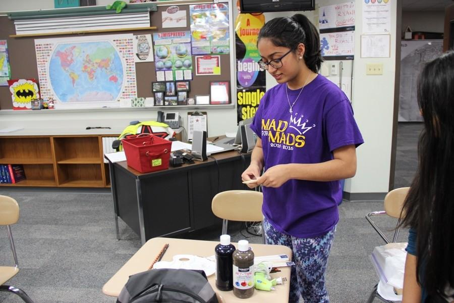 Coppell High School junior Rhea Tibrewal explains how to create a wand on Thursday in room B203. Tibrewal is the president and founder of the recently created CHS Harry Potter Club.
