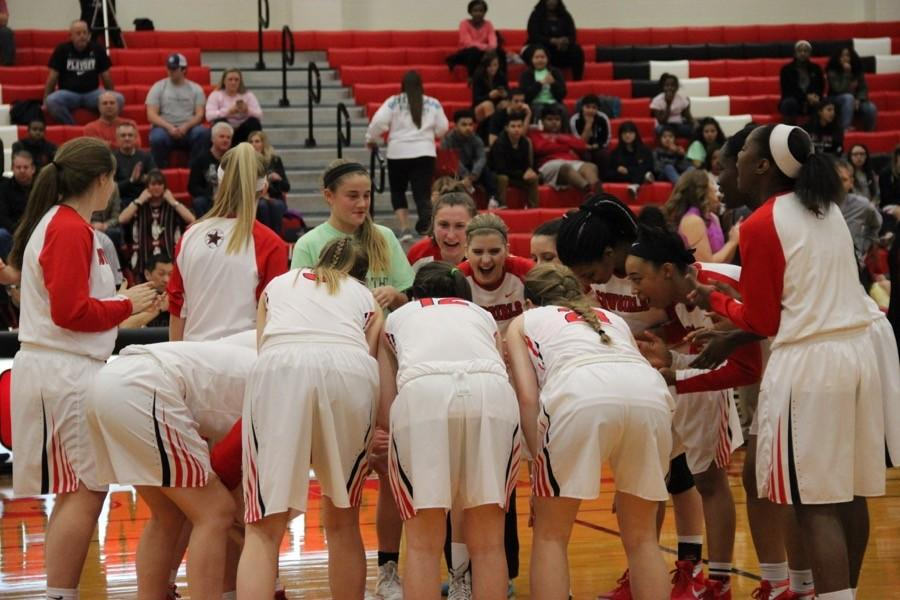 Coppell+Cowgirls+varsity+basketball+team+comes+together+to+get+ready+before+Friday+night%E2%80%99s+game+in+the+large+gym.+The+Cowgirls+lost+to+Richland%2C+48-43.