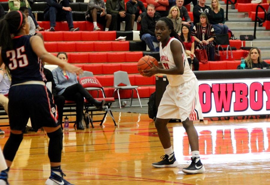 Coppell High School sophomore Rachel Okereke dribbles down the court during the beginning of the second quarter on Friday in the large gym. The Cowgirls lost to Richland, 48-43.