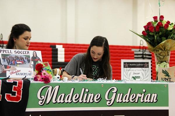 Coppell High School senior Madeline Guderian signs with University of North Texas on National Signing Day in the main gym on Wednesday. Guderian will play soccer with the university in the fall. Photo by Mallorie Munoz.