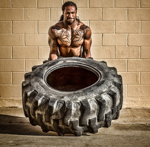 Isaiah Stanback flipping a tire during a workout, this is featured on the Steadfast website.