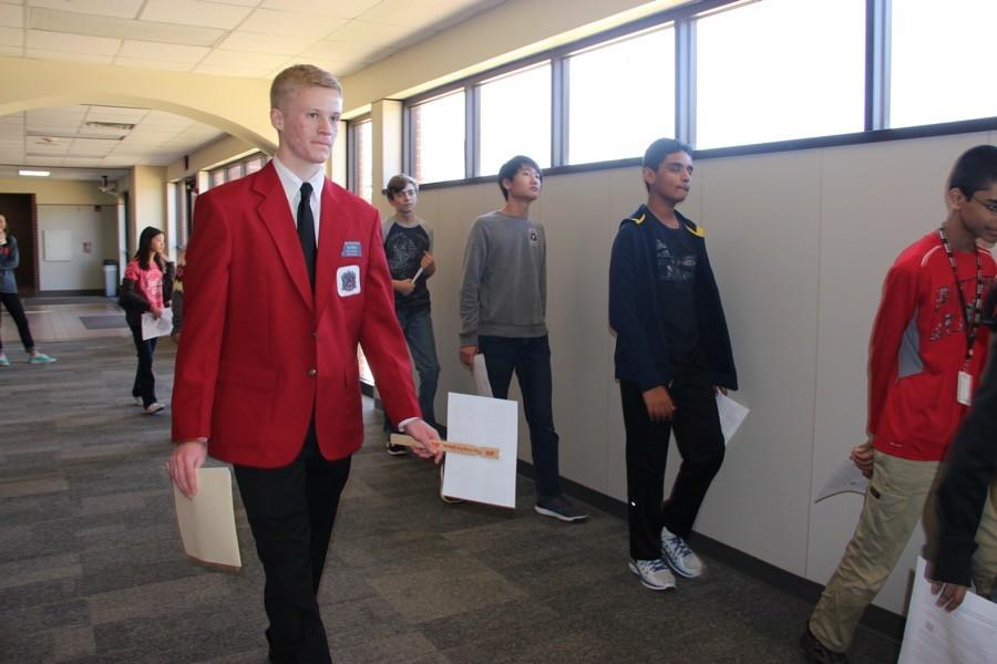 Coppell High School senior Red Jacket Alan Ritchie leads a tour of CMSN eighth graders around Coppell High School on Feb. 2. Every year, eighth graders from each of the three Coppell middle schools tour CHS.