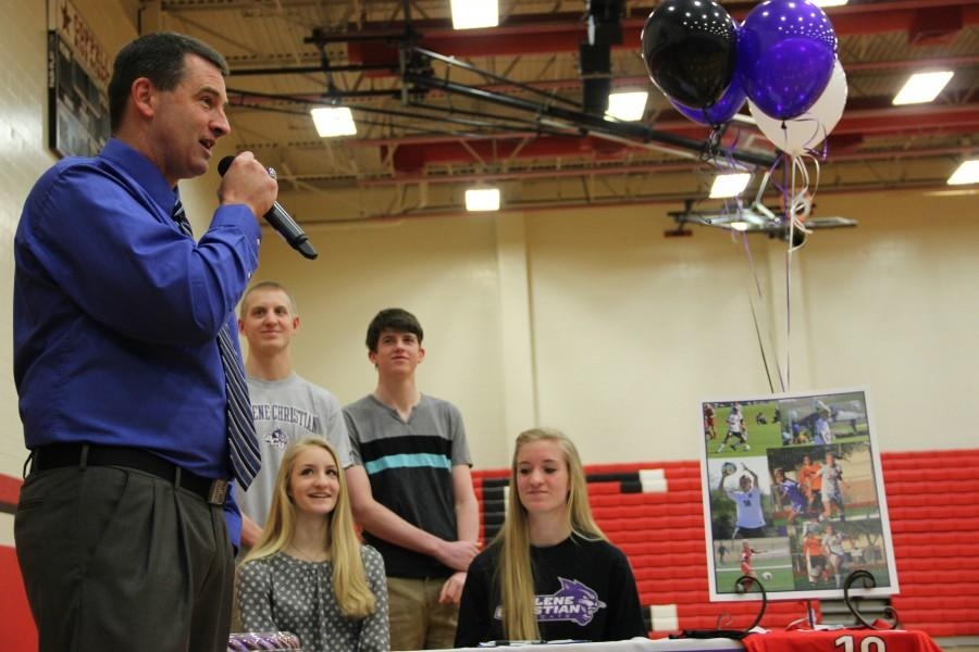 Former+Coppell+Cowgirl+soccer+coach+Chris+Stricker+talks+to+the+crowd+about+Shay+Johnson+at+signing+day.+Johnson+signed+with+Abilene+Christian+University+to+play+soccer.+Photo+by+Mallorie+Munoz.