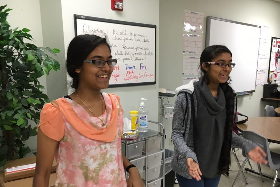 Sophomore twin sisters Dharshini and Varshini practice for their presentation on Friday, the 19th.