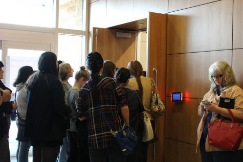 Fans of young adult novelist Marissa Meyer crowd around to try and hear Meyer speak in the crowded South Irving Library on Saturday. Meyer visited Irving as her fifth stop on her Stars Above Tour, to talk about her newest novel, Stars Above. Photo by Kelly Monaghan.