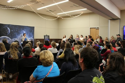 Marissa Meyer reads her fans The Little Mermaid by Hans Christian Anderson as her newest novel, The Stars Above, was inspired by the story. Meyer visited the South Irving Library on Saturday for her fifth stop on her Stars Above Tour. Photo by Kelly Monaghan.