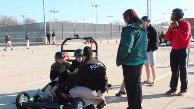 Students go through drunk driving simulation in forensics class