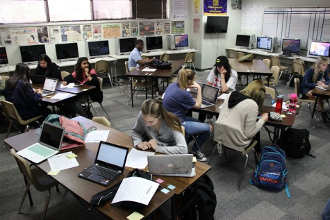 The Coppell High School newspaper staff works hard to produce their next issue of the paper, while promoting print as well as web content in celebration of National Scholastic Journalism week. Issues are printed and created 6 times each school year. Photo By Chelsea Banks.