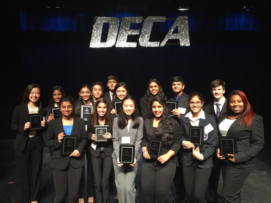 All 15 members from the Coppell High School DECA team celebrate their win at competition at North Garland High School on Saturday. Photo courtesy Sakina Deresalamwala