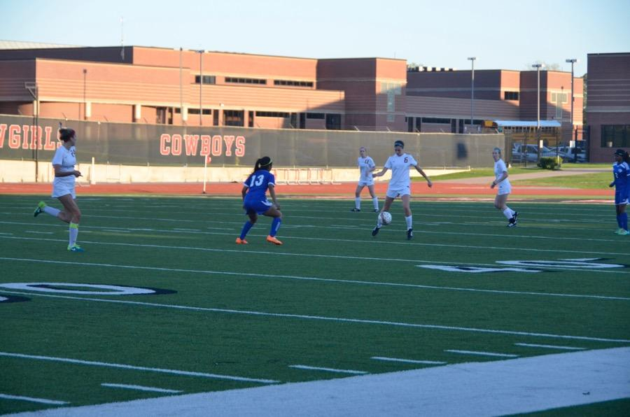 Coppell+High+School+senior+Kate+Kaiser+jumps+to+receive+the+soccer+ball+on+March+24+at+Buddy+Echols+field.+Coppell+Cowgirls+defeated+Duncanville+1-0+in+the+first+round+of+playoffs.