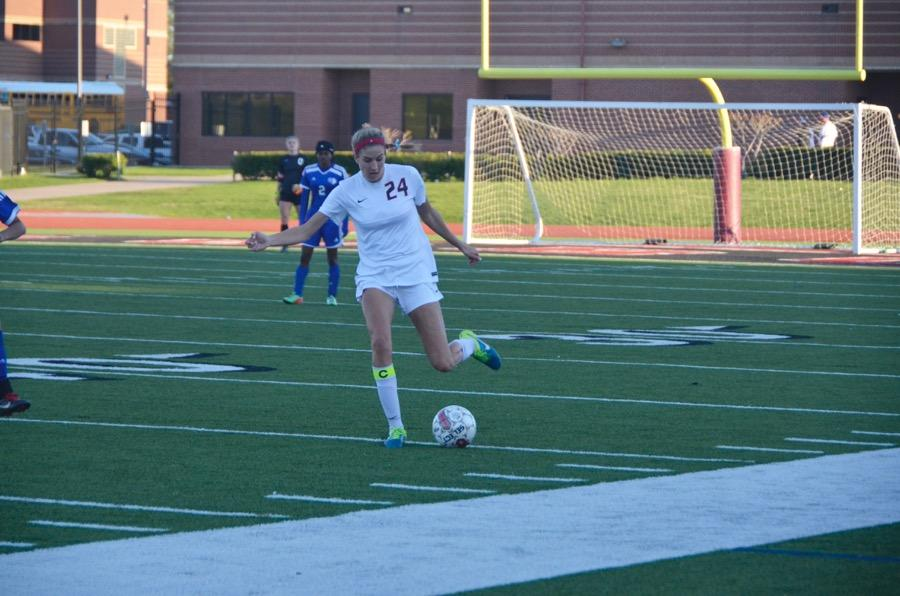 Coppell+High+School+senior+Emma+Jett+prepares+to+kick+the+soccer+ball+on+March+24+at+Buddy+Echols+field.+Coppell+Cowgirls+defeat+Duncanville+1-0+in+the+first+round+of+playoffs.+