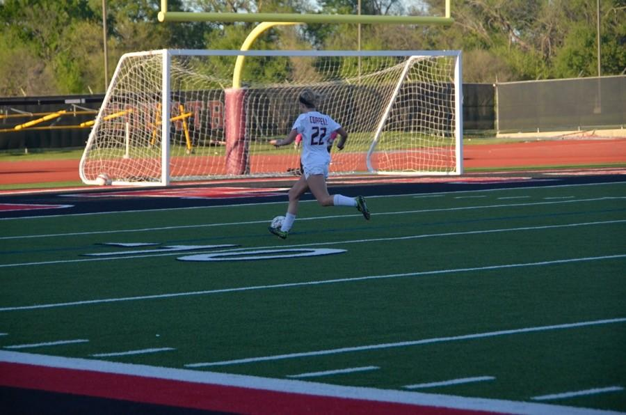 Coppell+High+School+junior+Erin+Brown+gets+ready+to+kick+the+soccer+ball+into+the+goal+on+March+24+at+Buddy+Echols+field.+Coppell+Cowgirls+defeated+Duncanville+1-0+in+the+first+round+of+playoffs.