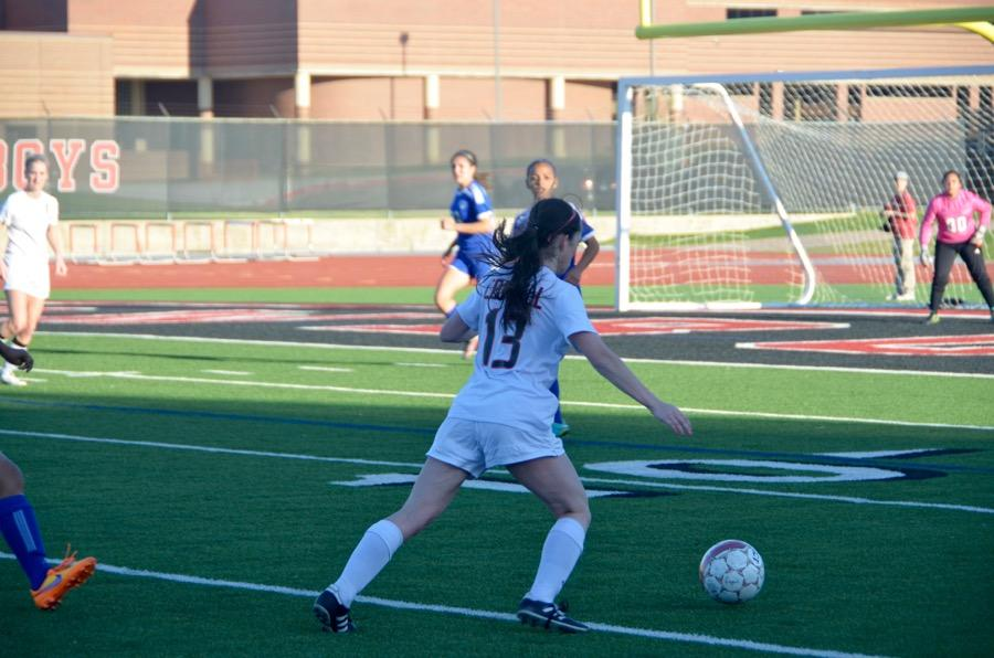 Coppell+High+School+senior+Madeline+Guderian+prepares+to+kick+the+soccer+ball+into+the+goal+on+March+24+at+Buddy+Echols+field.+Coppell+Cowgirls+defeated+Duncanville+1-0+in+the+first+round+of+playoffs.