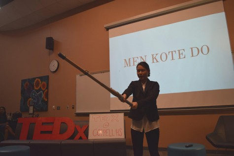 """Sophomore Sol Hong's TED talk consisted of """"the way of the sword."""" Hong depicted the way a sword should be used by performing various stunts. Photo by Pranathi Chitta."""