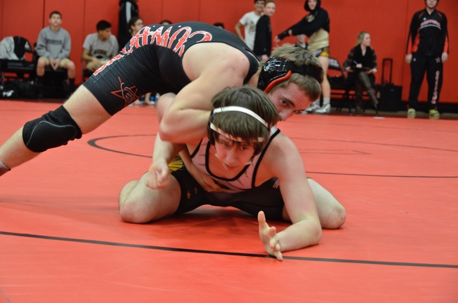 Coppell High School senior Austin Hanson pins his Panthers opponent down on Thursday at the Coppell High School small gym. The JV wrestling team prepares to go against Flower Mound in the District 6 JV Championships this Wednesday.