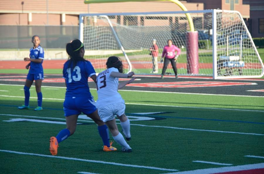 Coppell+High+School+senior+Madeline+Guderian+fights+for+the+soccer+ball+on+March+24+at+Buddy+Echols+field.+Coppell+Cowgirls+defeated+Duncanville+1-0+in+the+first+round+of+playoffs.