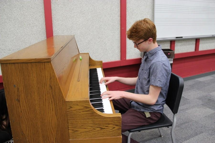 Coppell High School sophomore Brandon Johnson practices playing the piano in AP music theory on March 23 in the choir room. Students in AP music theory took a half-day AP practice exam yesterday and are reviewing musical concepts in class today.