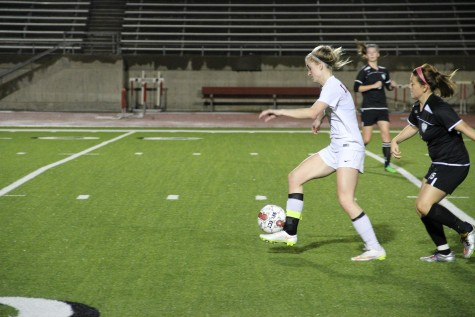 Coppell senior Shay Johnson dribbled down the field on senior night against Haltom. The Cowgirls scored seven goals in the first half to ease to a 12-0 win to end the regular season. Photo by Ayoung Jo.