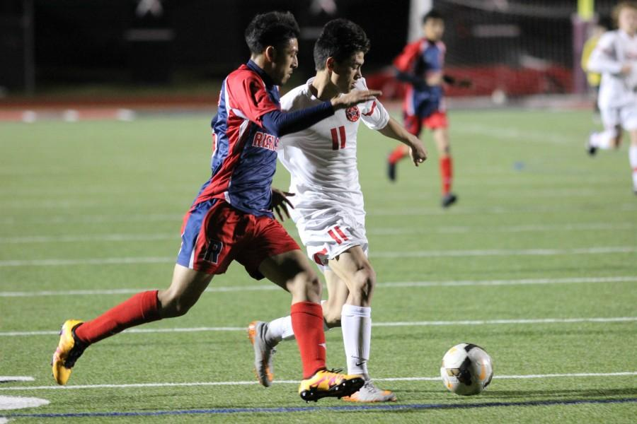 Junior forward Nick Taylor attempts to dribble past the Richland defense in the Cowboys' 9-0 victory at Buddy Echols field. Taylor had three goals in the first 18 minutes to lead the Cowboys to a win.