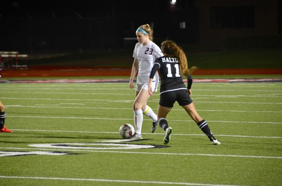 Coppell High School junior Sarah Houchin looks to kick the soccer ball last Friday at Buddy Echols Field. The Varsity Coppell Cowgirls won 4-1 against Haltom.