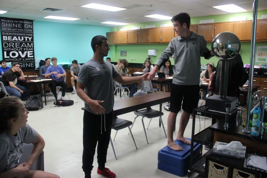 Coppell High School Donna Murrell's fifth period conceptual physics class performs a lab using the Van De Graaff Generator. This activity does not work well on humid days, so Murrell made sure she didn't use it in the summer or any rainy days throughout the year.