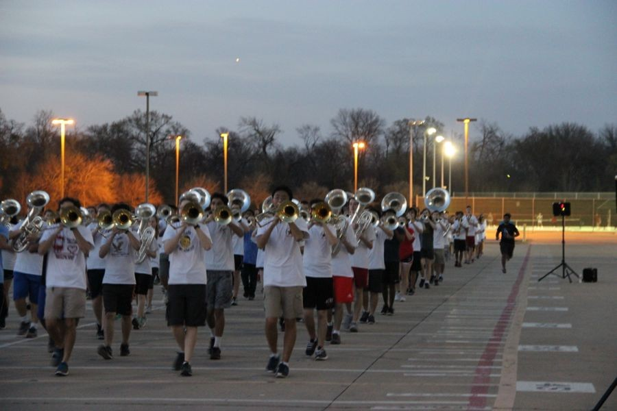 Coppell High School marching band practices playing songs and walking in formation on Feb. 29. The band practices Monday and Friday after school before Spring Break to be prepared for the 15th annual Saint Patrick's Day parade in London.