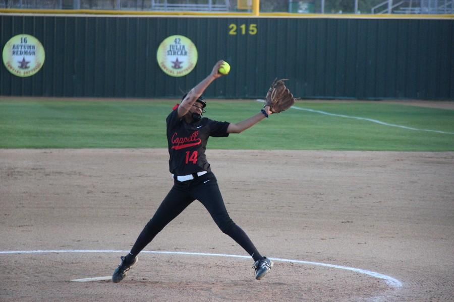 Coppell+High+School+freshman+pitcher+Nora+Rodriguez+pitches+a+ball+in+the+first+inning+of+Tuesday+night%E2%80%99s+game+against+Trinity+High+School%E2%80%99s+Lady+Trojans.+The+Cowgirls+won+at+the+end+of+the+fifth+inning+with+a+score+of+10-0+and+played+at+the+Coppell+ISD+Baseball%2FSoftball+Complex+at+Coppell+Middle+School+West.+Photo+by+Kelly+Monaghan.