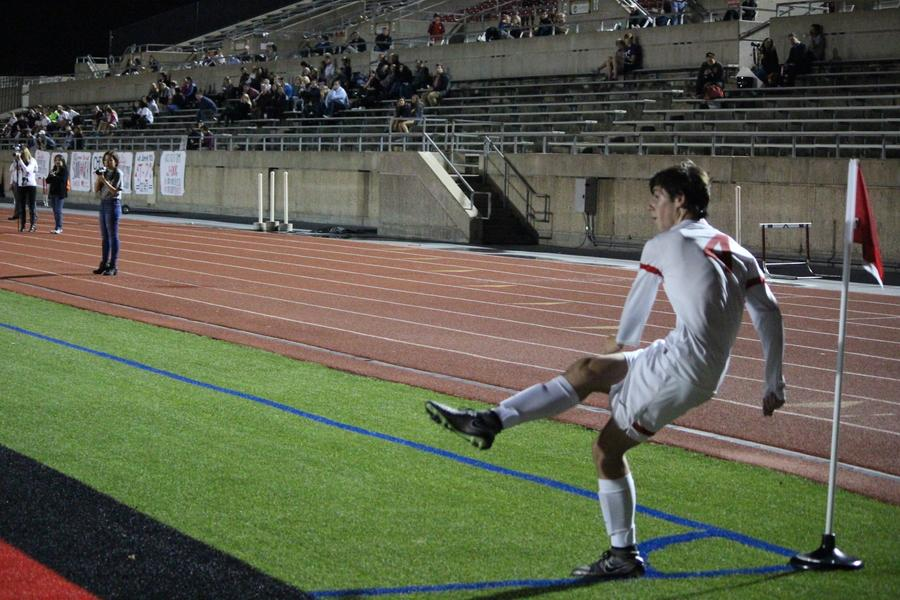Coppell High School sophomore forward Wyatt Priest goes in for a corner kick in the second half of Tuesday night's game against the Colleyville Heritage Panthers. The Cowboys won 3-0 at Buddy Echols Field in their second to last regular season game. Varsity, JV and JV2 will all play their last regular season games this Friday before Varsity moves on to playoffs.
