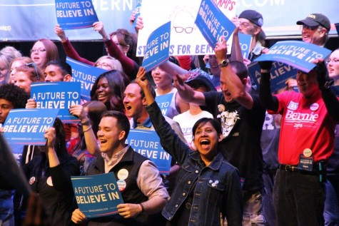 Supporters of presidential candidate Bernie Sanders cheer after Sanders stated his plans to raise minimum wage and his ideas to create a free college tuition for the future of America. Attendees gathered at the Verizon Center in Grand Prairie on Feb. 27 to show their support. Photo by Amanda Hair.