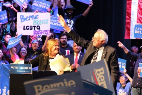 Democratic presidential candidate Bernie Sanders waves in conclusion of the rally with his wife Jane O'Meara Sanders. More than 7,000 attended the rally on Saturday at the Verizon Theatre at Grand Prairie. Photo by Amanda Hair.